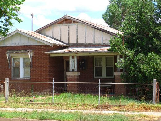 Abandoned brick house with fence in small town Wellington Central West NSW