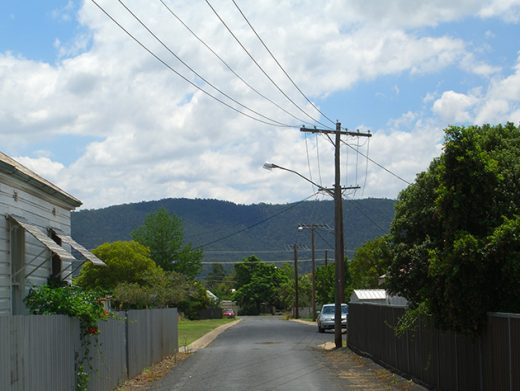 Laneway in Country town with telephone wires and mountain background Wellington Central West NSW